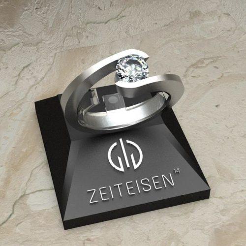 Solitär-Ring aus Weißgold mit eingespannten Diamant